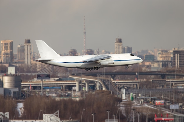 Largest cargo and military strategic airplane taking off at sunny day