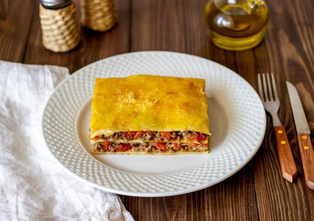 Lasagna on a wooden surface italian cuisine
