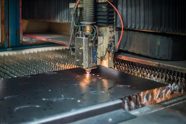 Laser cutting machine cutting steel plate in factory