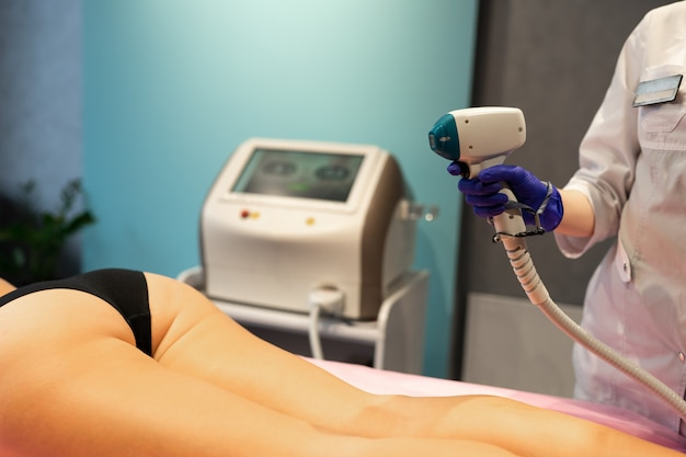 Laser depilation leg hair removal therapy