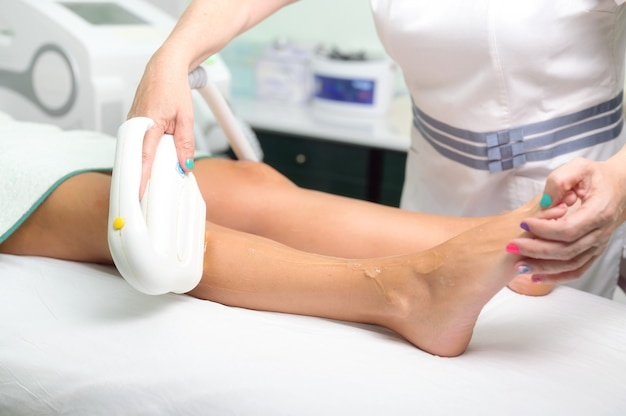 Laser epilation and cosmetology in beauty salon cosmetology spa and hair removal concept