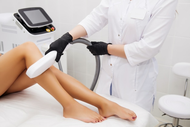 Laser epilation and cosmetology in beauty salon. hair removal procedure. laser epilation, cosmetology, spa, and hair removal