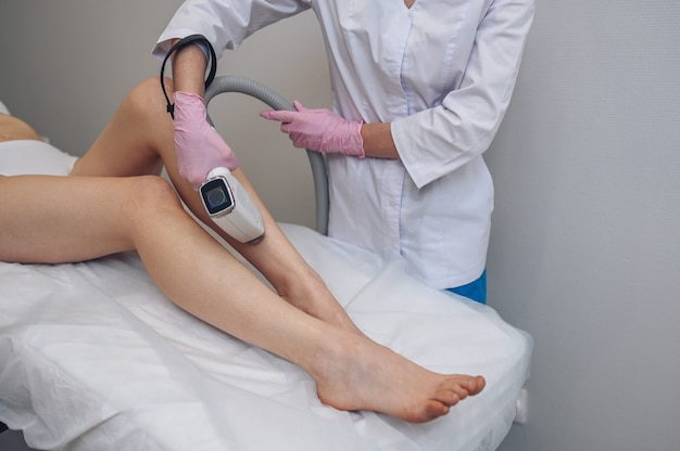 Laser epilation and cosmetology in beauty salon hair removal procedure laser epilation cosmetology