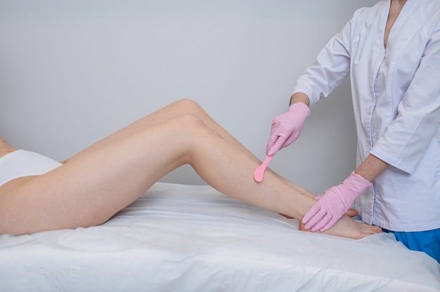 Laser epilation and cosmetology in beauty salon, spa concept