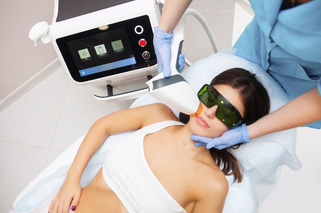 Laser epilation and cosmetology in beauty salon.