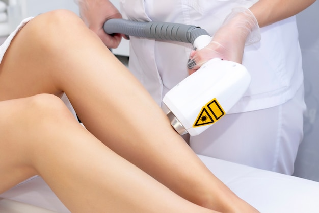 Laser hair removal legs. laser epilation and cosmetology. hair removal cosmetology procedure. laser epilation and cosmetology. cosmetology and spa concept