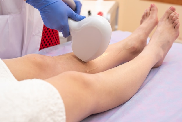 Laser hair removal process in a shugaring beauty salon