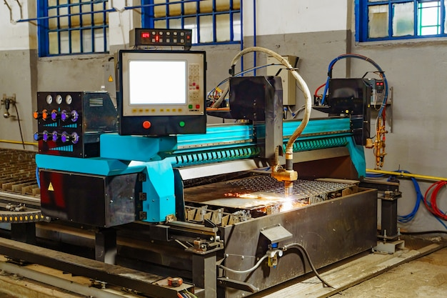 Laser machine metallurgical works to cutting metal indoors room. industrial equipment for cutting metal.