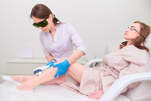 Laser procedure in the clinic of laser cosmetology.