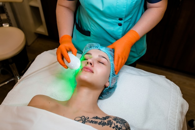 Laser treatment to remove facial skin imperfections