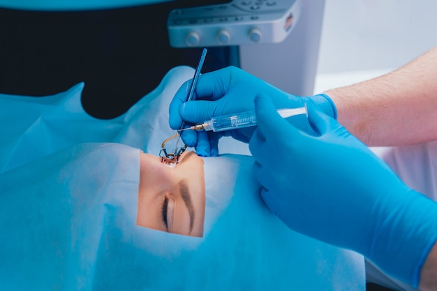 Laser vision correction. a patient in the operating room during ophthalmic surgery. eyelid speculum. lasik treatment.