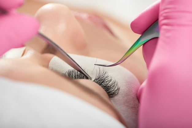 Lashmaking process by cosmetological professional.