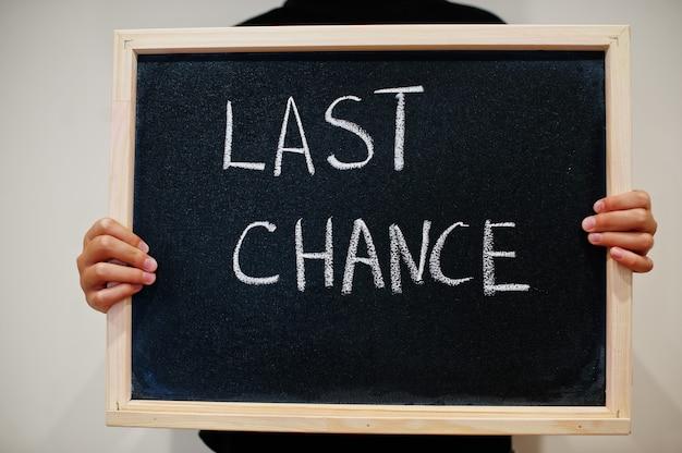 Last chance written on chalkboard