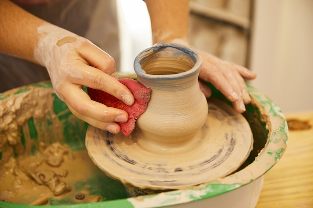 Last moments of molding a pottery
