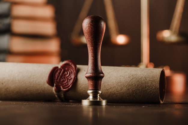 Last will and old wax seal close-up in notary office