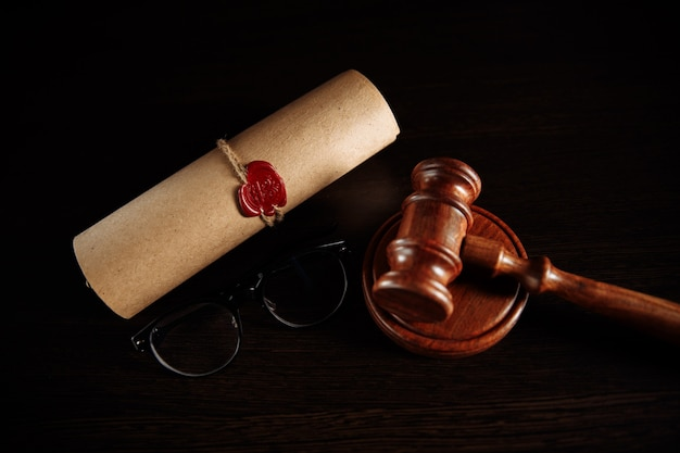 Last will and testament and glasses with wooden gavel.