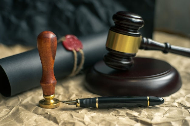 Last will and testament on yellowish paper with wooden judge gavel document is mock-up