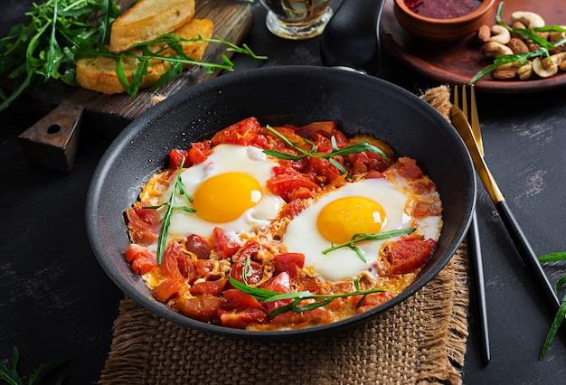 Late breakfast - fried eggs with vegetables. shakshuka. arabic cuisine. kosher food.