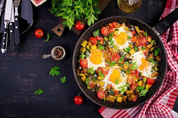 Late breakfast - fried eggs with vegetables. shakshuka. arabic cuisine
