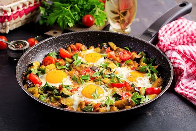 Late breakfast - fried eggs with vegetables. shakshuka. arabic cuisine.