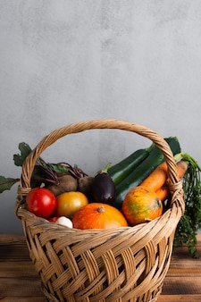 Lateral view beautiful basket full with vegetables