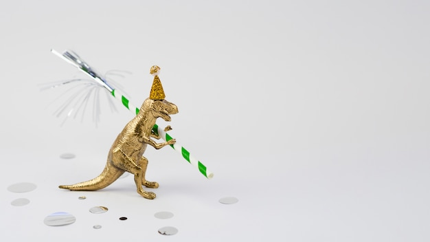 Lateral view golden t-rex with birthday hat