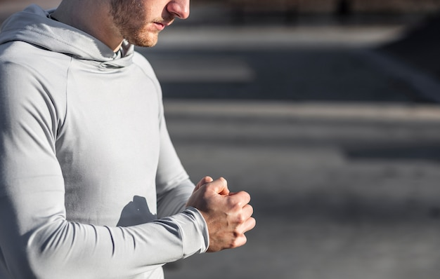 Lateral view man warming up his hands