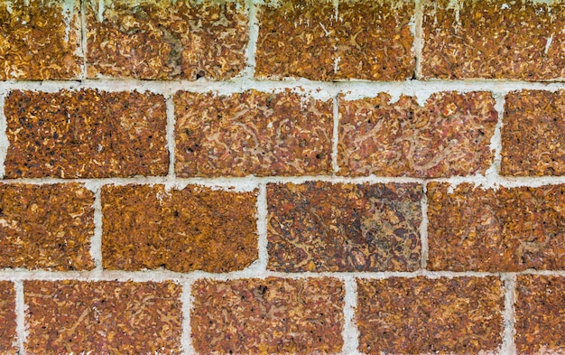 Laterite stone wall surface with cement background