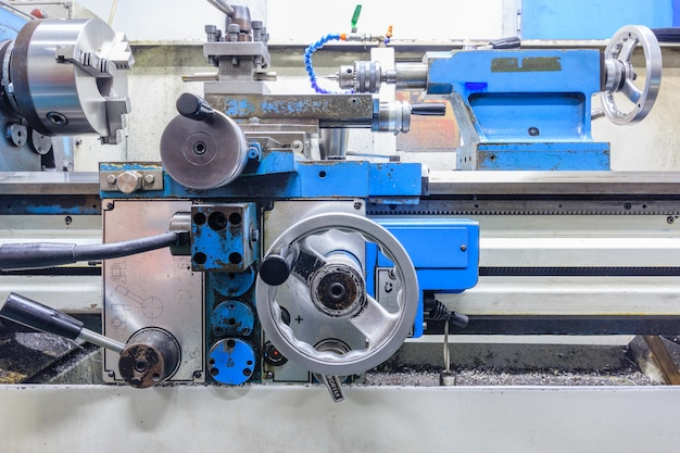 Lathe machine in a workshop. part of the lathe. lathe machine is operation on the work sho