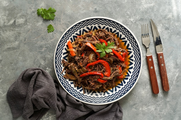 Latin america food. ropa vieja with fried plantains