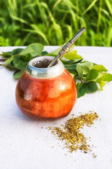 Latin america herbal tea in mate calabash with bombilla