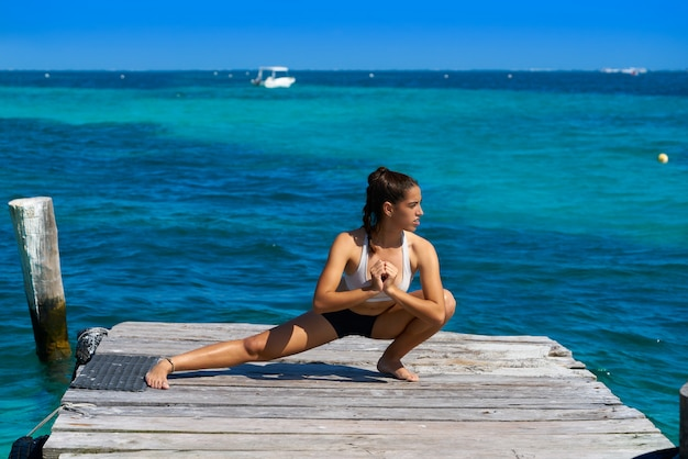 Latin athlete woman stretching in caribbean