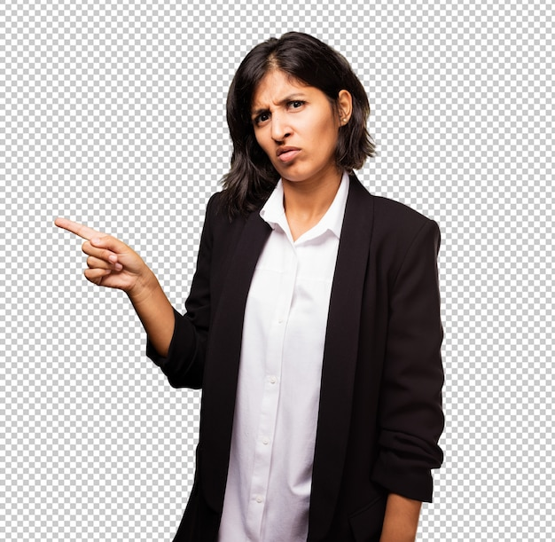 Latin business woman pointing space