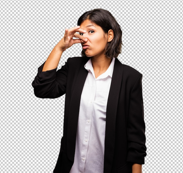 Latin business woman smelling bad