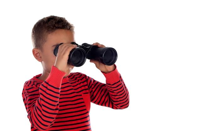 Latin child looking through binoculars