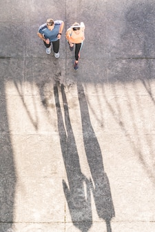 Latin couple running or jogging together outdoors.