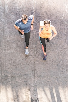 Latin couple running or jogging together outdoors