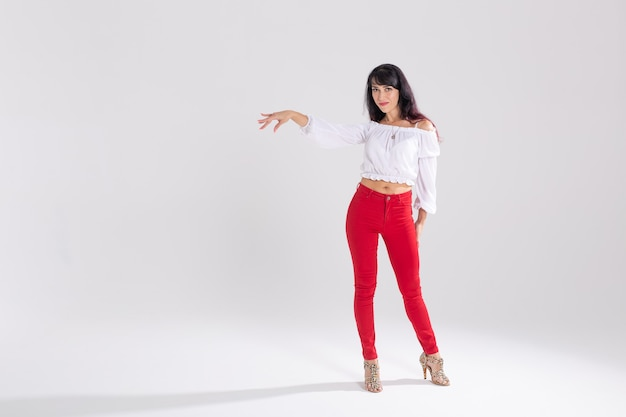 Latin dance, contemporary dance, bachata solo and cha-cha-cha concept - portrait of a young woman