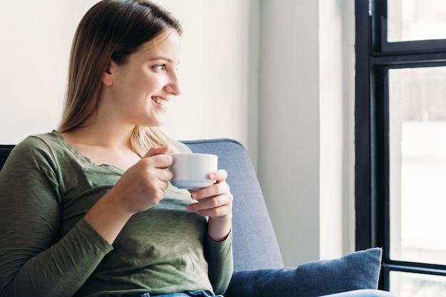 Latin woman enjoying cup of coffee