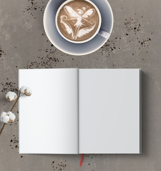Latte art of a fairy and a blank open book on grey