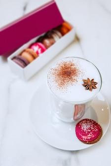 Latte chocolate glass cup saucer macaroon dessert