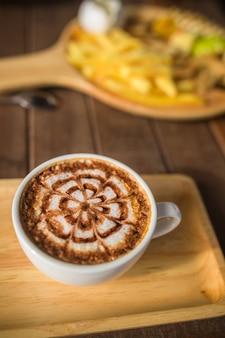Latte coffee art on the wooden desk