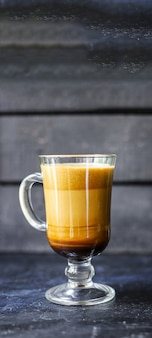 Latte coffee cappuccino dalgona in transparent glass sweet drink