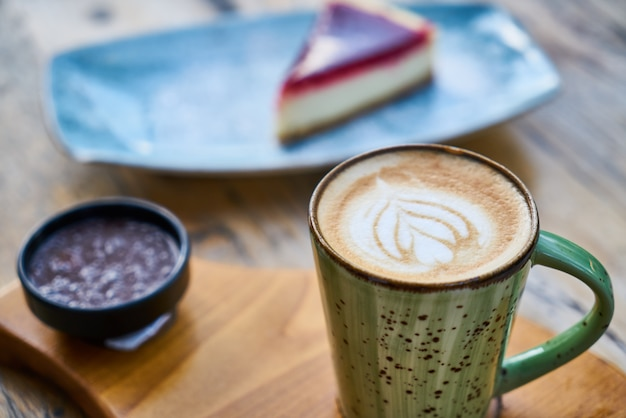 Latte coffee and cheesecake on a table