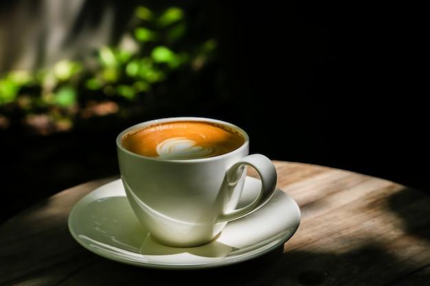 Latte coffee on low light wood floors