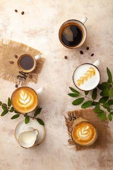 Latte, espresso, cappuccino coffee cups on beige vintage pastel