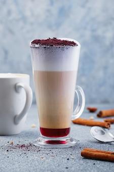 Latte macchiato with cocoa powder and cinnamon