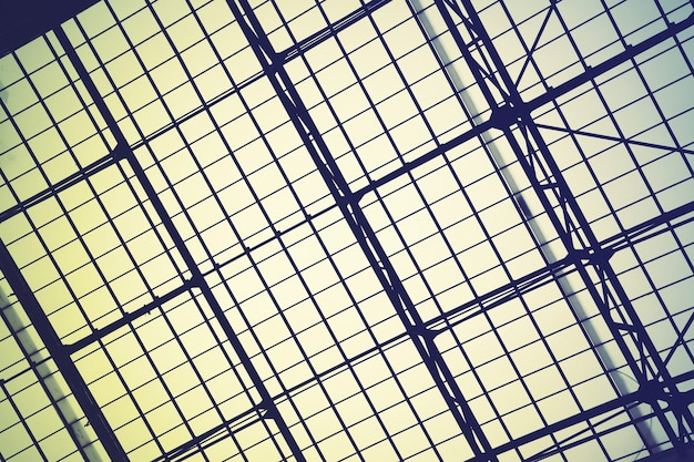 Lattice frame of huge vintge skylight window -  abstract architectural background.  retro style filtered image