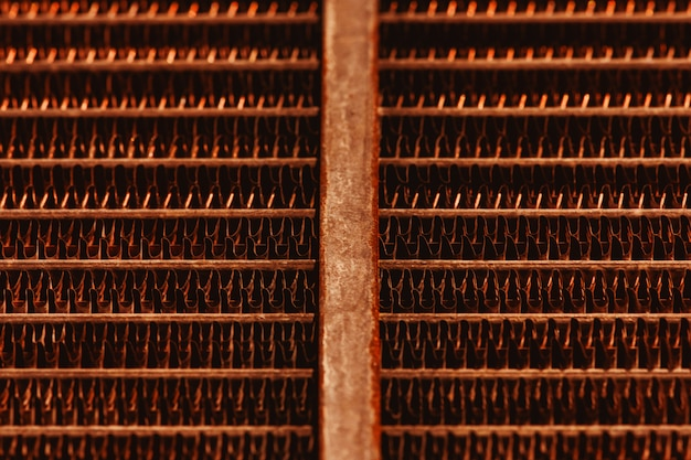 Lattice texture of old rusty radiator with copy space