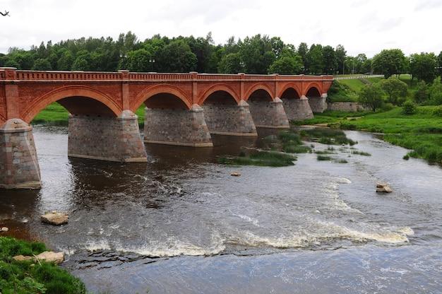 Latvia, kuldiga brick bridge. it was built in 1874 and is the longest operating brick bridge in europe
